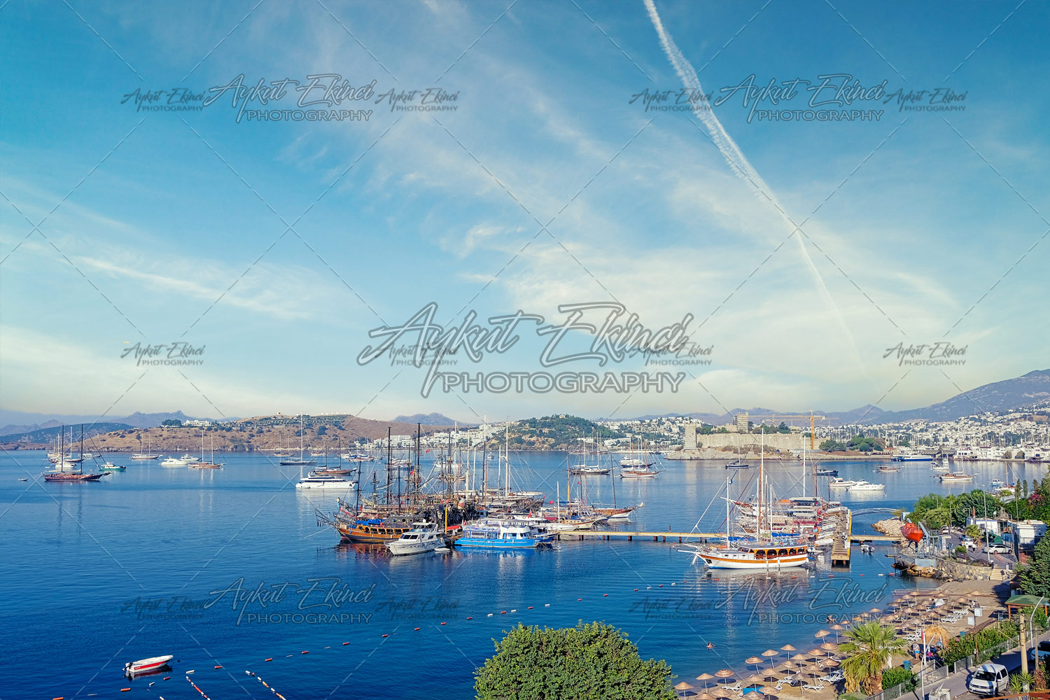 Bodrum Downtown with castle, beach and marina. View of Bodrum Beach, traditional white houses, boats, yachts in Bodrum town Turkey.