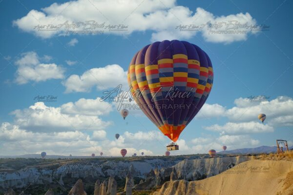 Hot air balloon flying over spectacular Cappadocia Turkey